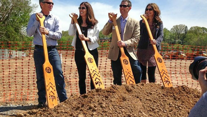 New  Belgium has promoted Christine Perich to company president. She is pictured here, second from left, at groundbreaking for the Asheville brewery.