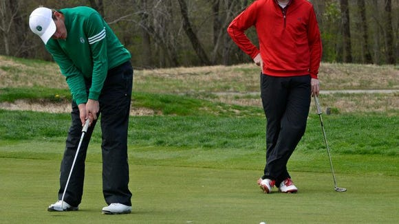 Christ School's Jonathan Rector putts during Tuesday's Buncombe County tournament at Broadmoor Golf Links.