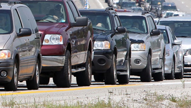 KY10SPEEDWAY TRAFFIC JAM LOCAL JULY 9, 2011 Traffic backs up on I-71 south at the exit to Kentucky Speedway.  (Motorists i spoke with said traffic was backed up more than 10 miles by 2:30 pm)   The Enquirer/Patrick Reddy