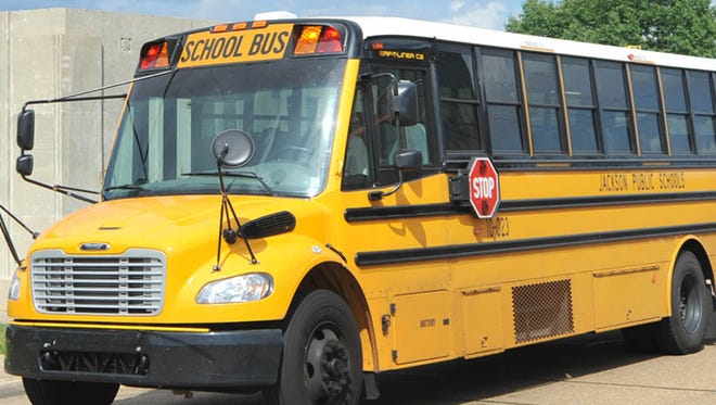 A school bus waits outside Murrah High School. Having students arrive on time is one of the priorities Jackson School leaders must address or face a state takeover.