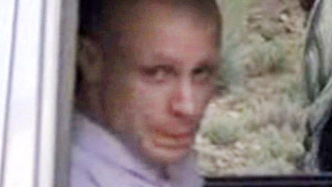 In this image taken from video obtained from Voice Of Jihad Website, which has been authenticated based on its contents and other AP reporting, Sgt. Bowe Bergdahl sits in a vehicle guarded by the Taliban in eastern Afghanistan. The Taliban have released a video showing the handover of Bergdahl to U.S. forces in eastern Afghanistan.