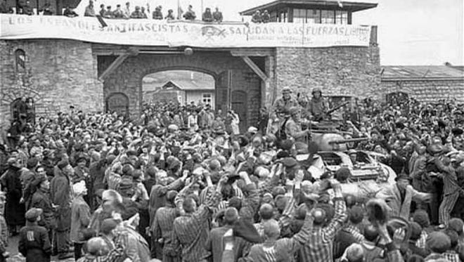 Inmates of the Mauthausen concentration camp welcome members of the U.S. Third Army's Eleventh Division as liberators.