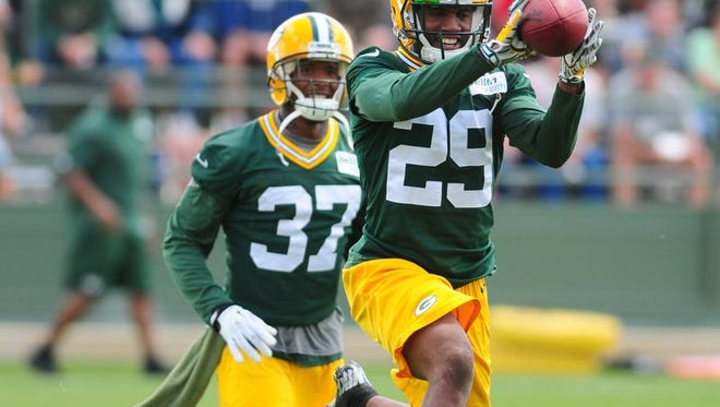 Green Bay Packers cornerback Casey Hayward catches the ball in front of cornerback Sam Shields during OTA practice at Ray Nitschke Field, Tuesday, June 3, 2014.