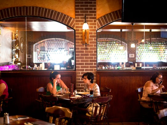 Ingrid Venero and Natalia Rivera eat at an Argentinian