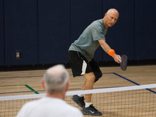 Clayton Henry knocks a ball back over the net during a pickleball match at Meerscheidt Recreation Center on Wednesday, Sept.13.
