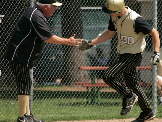 Franklin coach Jim Hughes and Joel Kornhoff, shown here rounding third after a home run in the 2010 state semifinals, played key roles in the Sabers back-to-back state championships.
