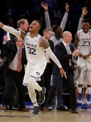 Seton Hall guard Derrick Gordon (32) reacts after hitting a 3-point shot late in the NCAA college basketball game against Creighton during the Big East men's tournament, Thursday, March 10, 2016, in New York. Seton Hall won 81-73. (AP Photo/Julie Jacobson)