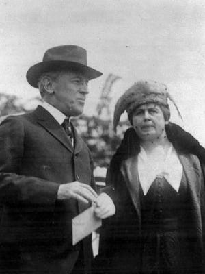 U.S. President Woodrow Wilson and wife, first lady Edith Bolling Wilson attend the opening of the airplane mail service, May 15, 1918, in Washington, D.C.