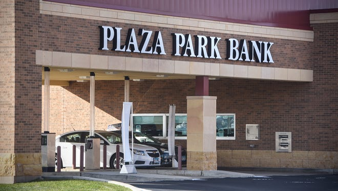 Customers go through the drive through at Plaza Park Bank Thursday, Nov. 9, in Waite Park.