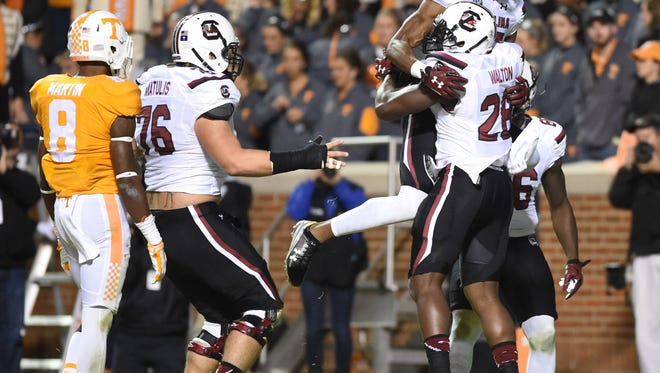 South Carolina players celebrate a touchdown against Tennessee during the second half of an NCAA college football game at Neyland Stadium in Knoxville, Tenn. on Saturday, Nov. 7, 2015. (Adam Lau/Knoxville News Sentinel via AP)