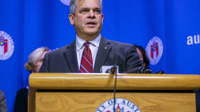 Austin Mayor Steve Adler, seen here at a COVID-19 briefing at City Hall on March 6, says he is worried that a recent spike in coronavirus cases will overwhelm local hospitals.
