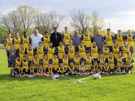 Boys lacrosse players with the Livonia Raptors want