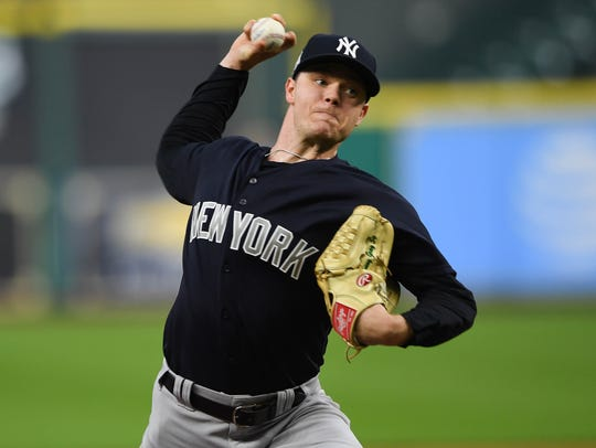 Yankees starting pitcher Sonny Gray delivers during