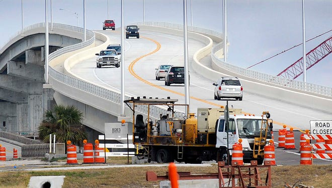 Traffic drives across the newly opened A. Max Brewer Bridge in Titusville in this January 2011 photo.