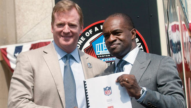 NFL Comissioner Roger Goodell, left, and NFLPA Executive Director DeMaurice Smith shake hands after signing their collective bargaining agreement at the Pro Football Hall of Fame in Canton, Ohio in 2011. Smith and Goodell met on Tuesday to discuss the conduct policy. Smith says that a new collective bargaining agreement needs to be reached.