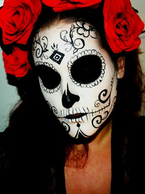 Nikkie Brister of Zoom Hair Studio in Red Bank can create full face makeup looks for Halloween.