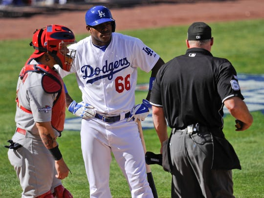 Dodgers rookie Yasiel Puig (66) stares down home-plate umpire Ted Barrett 5737bd02882