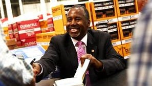 Ben Carson, shown signing books in North Naples, was tapped by President-elect Donald Trump to become secretary of the Department of Housing and Urban Development.