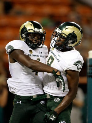 Colorado State wide receiver Michael Gallup (4) reacts with wide receiver Detrich Clark (8) after a Gallup touchdown against Hawaii during the third quarter of the NCAA college football game against Hawaii, Saturday, Sept. 30, 2017, in Honolulu. (AP Photo/Marco Garcia)