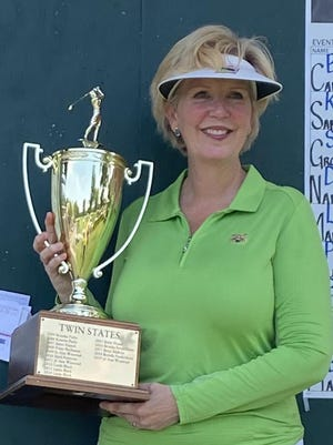 Fort Smith resident Jo Ann Winstead poses with the trophy that she won after taking the championship of the Twin States Ladies golf tournament recently held at both Ben Geren and Hardscrabble.