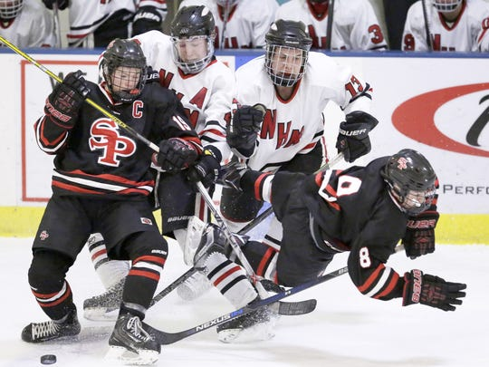 Cole Caufield, left, had 50 goals and 79 points for Stevens Point Area Senior High this winter.