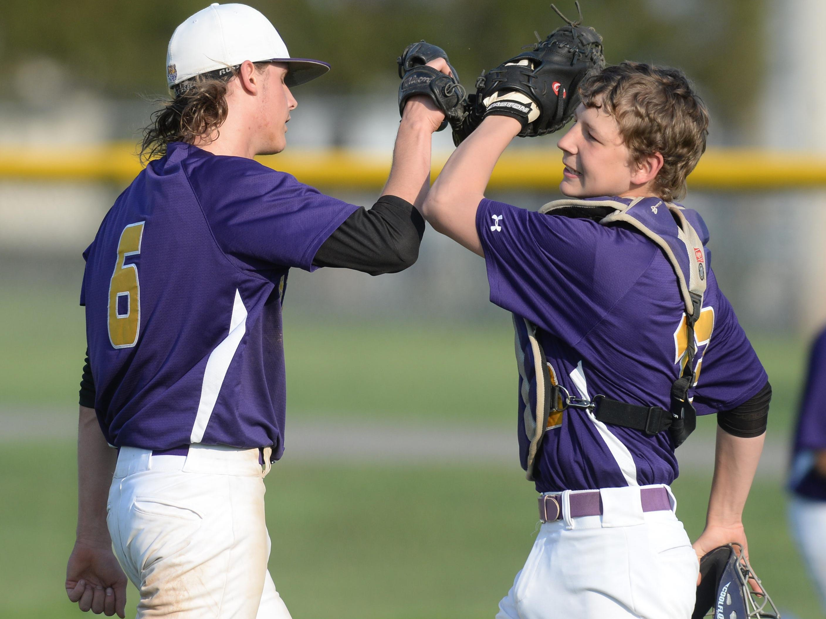 Hagerstown's Sam Reagan is greeted by catcher Cameron Purtha after a game. The Tigers, the defending TEC champion, will play Class A Sectional 56 next season.