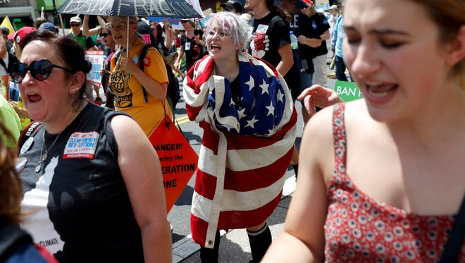 Protesters yell during a demonstration in downtown on Sunday, July 24, 2016, in Philadelphia. The Democratic National Convention starts Monday.