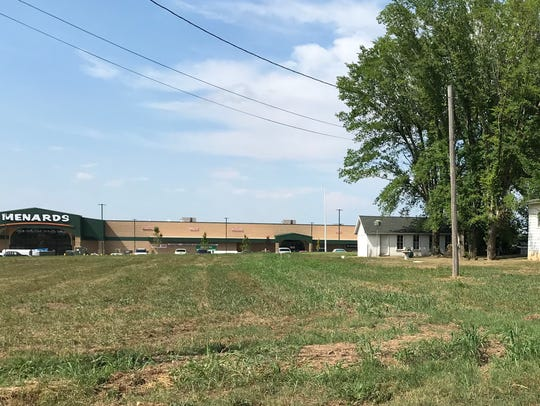 The old farmhouse and barn near the new Menards near West Sunshine will stay — at least for now.
