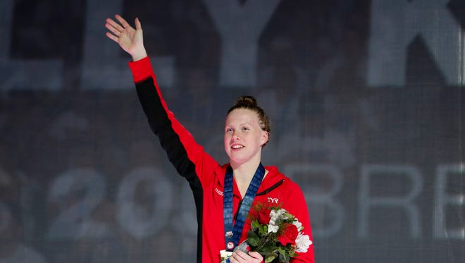 Lilly King celebrates after winning the women's 200 meter breaststroke final in the U.S. Olympic swimming team trials at CenturyLink Center.