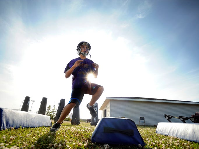 Athletes run the drills and work on their plays during football practice on Tuesday, Aug. 5, 2014 at Two Rivers High School in Two Rivers. Matthew Apgar/HTR Media
