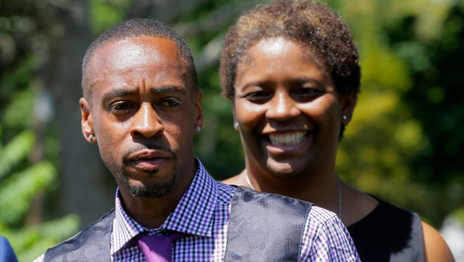 Dion Harrell and his aunt, Peggy Bennett of Long Branch, speak briefly during a press conference held after Long Branch resident Dion Harrell's wrongful conviction for a rape in 1999 is vacated based on new DNA evidence providing his innocence before Judge Ronald L. Reisner's courtroom outside Monmouth County Courthouse in Freehold, NJ Wednesday August 3, 2016.