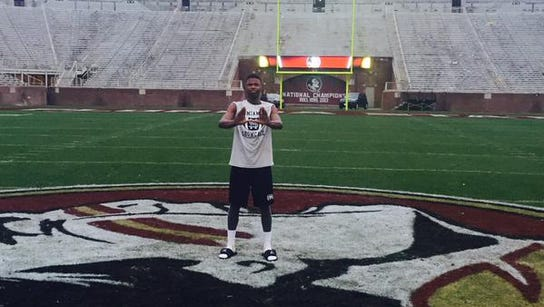 Al Blades Jr. throws up the U inside Doak Campbell