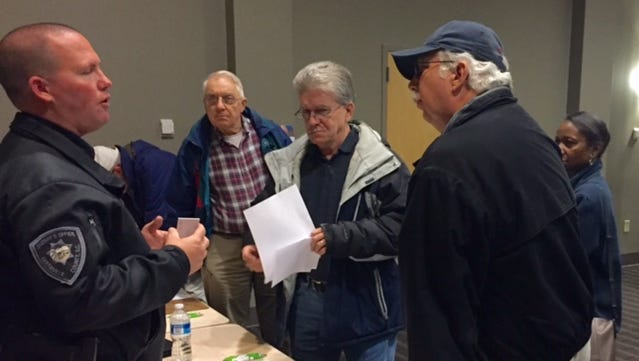 Berea residents get information from Greenville County Sheriff's Deputy Ryan Reid, who'll head the public safety task force, one of the focus committees in the community's future plan process.