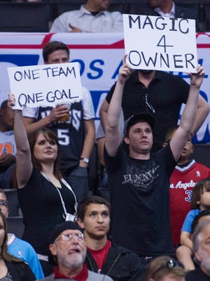 Fans hold up signs before the Clippers played the Warriors in Game 5 Tuesday.