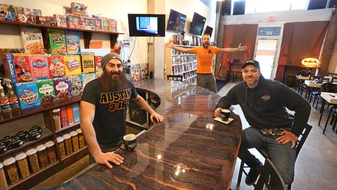 Co-owners Nick Andolina, left, Colin Delaney, middle, and Jason Hilton, right, at their new POP ROC on East Avenue.