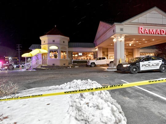 State College Police respond to a shooting at P.J. Harrigan's Bar & Grill at the Ramada Inn Thursday, Jan. 24, 2019, in State College, Pa. (Abby Drey/Centre Daily Times via AP)