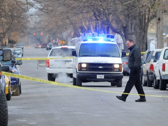 Law enforcement investigate the scene on where a woman