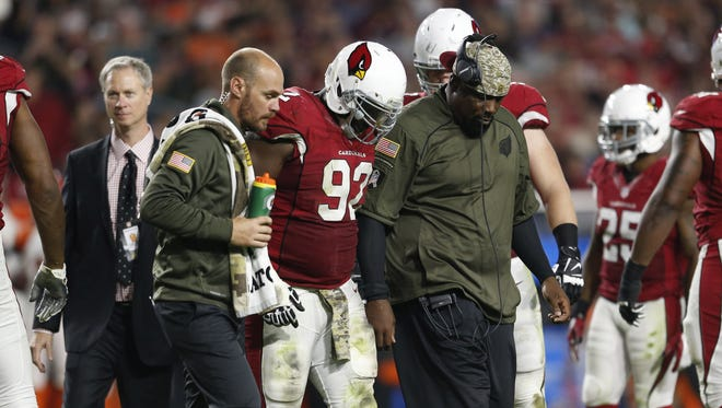 Arizona Cardinals DT Frostee Rucker (92) walks off the field after an injury playing against the Cincinnati Bengals during NFL action November 22, 2015 in Glendale, Ariz.