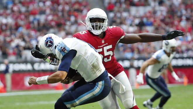 Cardinals outside linebacker Chandler Jones (55) sacks Titans quarterback Marcus Mariota during the second quarter at University of Phoenix Stadium in Glendale on Sunday.