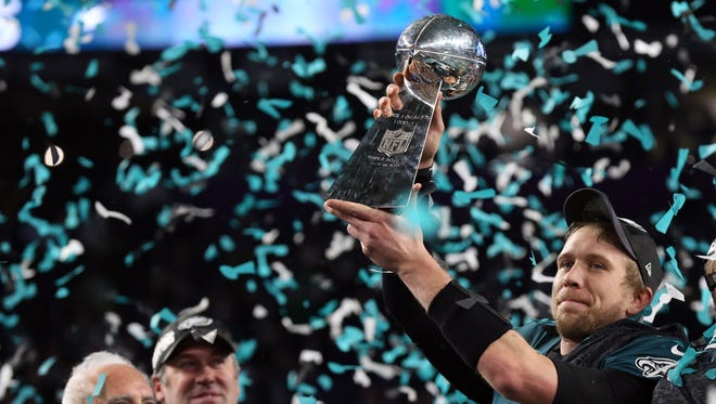 Philadelphia Eagles quarterback Nick Foles (9) celebrates with the Lombardi Trophy after defeating the New England Patriots 41-33 in Super Bowl LII at U.S. Bank Stadium.