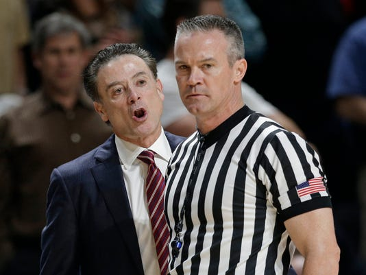 Louisville coach Rick Pitino, left, argues a call with an official during the second half of the team's NCAA college basketball game against Wake Forest in Winston-Salem, N.C., Wednesday, March 1, 2017. Wake Forest won 88-81. (AP Photo/Chuck Burton)