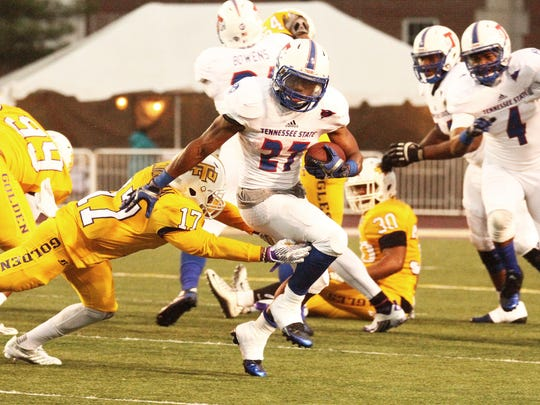 TSU running back Erick Evans (27) tries to elude the tackle of Tennessee Tech's Josh Cunningham (17) in 2015.