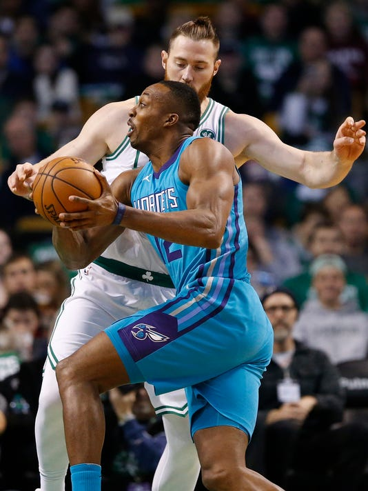 Charlotte Hornets' Dwight Howard (12) drives past Boston Celtics' Aron Baynes during the first quarter of an NBA basketball game in Boston, Friday, Nov. 10, 2017. (AP Photo/Michael Dwyer)