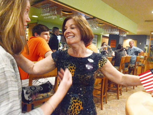 York County commissioner candidate Susan Byrnes greets supporters at the Yorktowne Hotel Tuesday night..