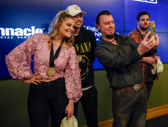 Lauren Alaina and Kane Brown pose for a selfie with