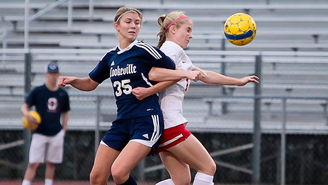 Cookeville's Kendall Powell (35) battles Oakland's AB Hawkins for the ball during the Lady Cavaliers' 1-0 win. Powell had the game-winning goal in the 102nd minute.