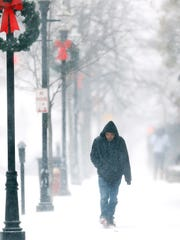 Don Trepicciont of Randolph walks down Park Place in Morristown through heavy snow and strong winds from a blizzard sweeping through New Jersey on Thursday morning that could bring up to a foot of snow to parts of the state while Morris County is expected to get only 2 to 4 inches.  January 4, 2018. Morristown, NJ.