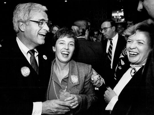 Tom Frey and his wife, Jacqueline Cady, share a laugh with Betsy Toole, who was the first person to suggest Frey run for county executive.