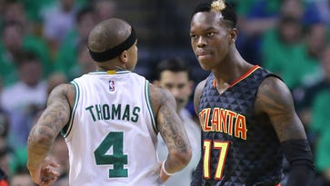 Boston Celtics guard Isaiah Thomas and Atlanta Hawks guard Dennis Schroeder get into a scuffle, with both being called for technical fouls in Game 3.