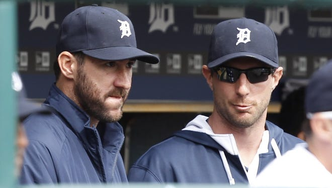 Detroit Tigers pitchers Justin Verlander and Max Scherzer, right, sit in the dugout April 6, 2014.